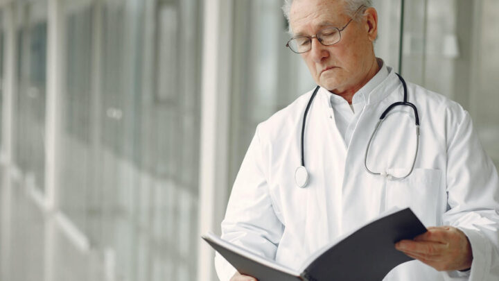doctor in uniform reading clinical record